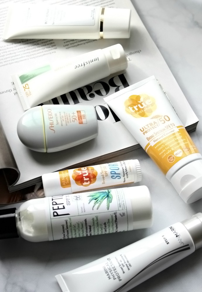 The Sunscreen Edit | The Best Sunscreens for Combination Skin - True Natural SPORT Stick SPF 30, True Natural Ultra Protect Antioxidant Sunscreen SPF 50, Erin's Faces Peptide SPF 30, Innisfree The Minimum Sun Cream SPF25, Jan Marini Marini Physical Protectant SPF 45, Shiseido Sports BB Broad Spectrum SPF 50+ WetForce, Institut Esthederm Into Repair Age Control Sunscreen, Exuviance Sheer Daily Protector SPF 50.