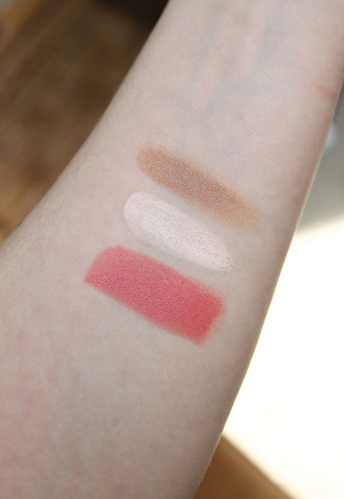Swatches Clean, Non-Toxic Makeup from Hush + Dotti, Pressed Mineral Foundation in Beach Girl, Organic Concealer in Jane, Organic Mascara, Organic Lipstick in T-Bone