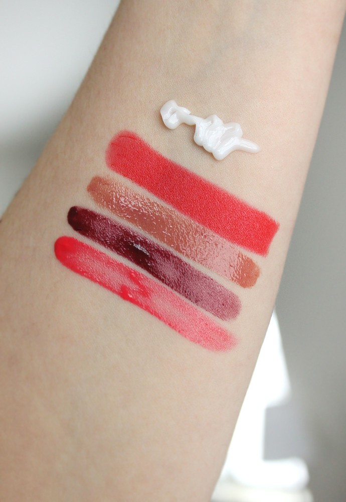 Swatches left to right:Chanel Rouge Coco Lip BlushTeasing Pink and Burning Berry,Rouge Coco Gloss Caramel,Rouge Allure Velvet Luminous Matte Lip Color Rouge Feu,La Creme Main.